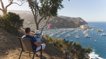 Catalina Island, Chanel Islands National Park, California, Casino View. Pier View. Father and Son. USA Flag. Boats.