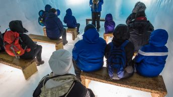 Iceland Travel, Ring Road, Langjokull, Iceland's second largest glacier. Into the glacier trip / adventure. Inside the glacier tunnel. Briefing. Group Talk.