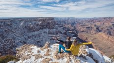 Grand Canyon National Park, Arizona, USA. Canyon View. Explorers. Winter Season. Arizona Attraction & Travel. Canyon Snow. Couple. Back View.