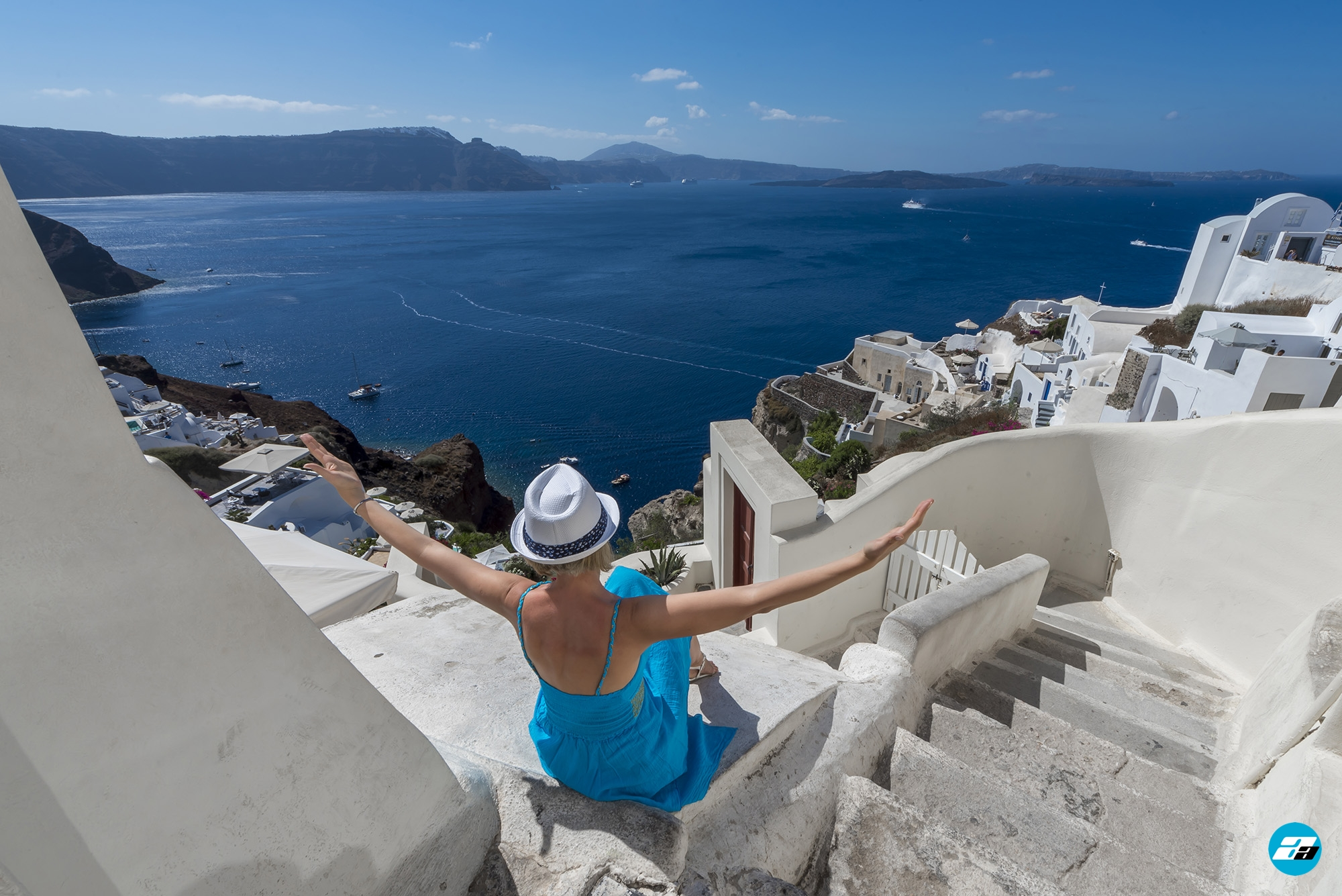 Oia Santorini Greece. Oia stairways. Fashion model. Blue dress.