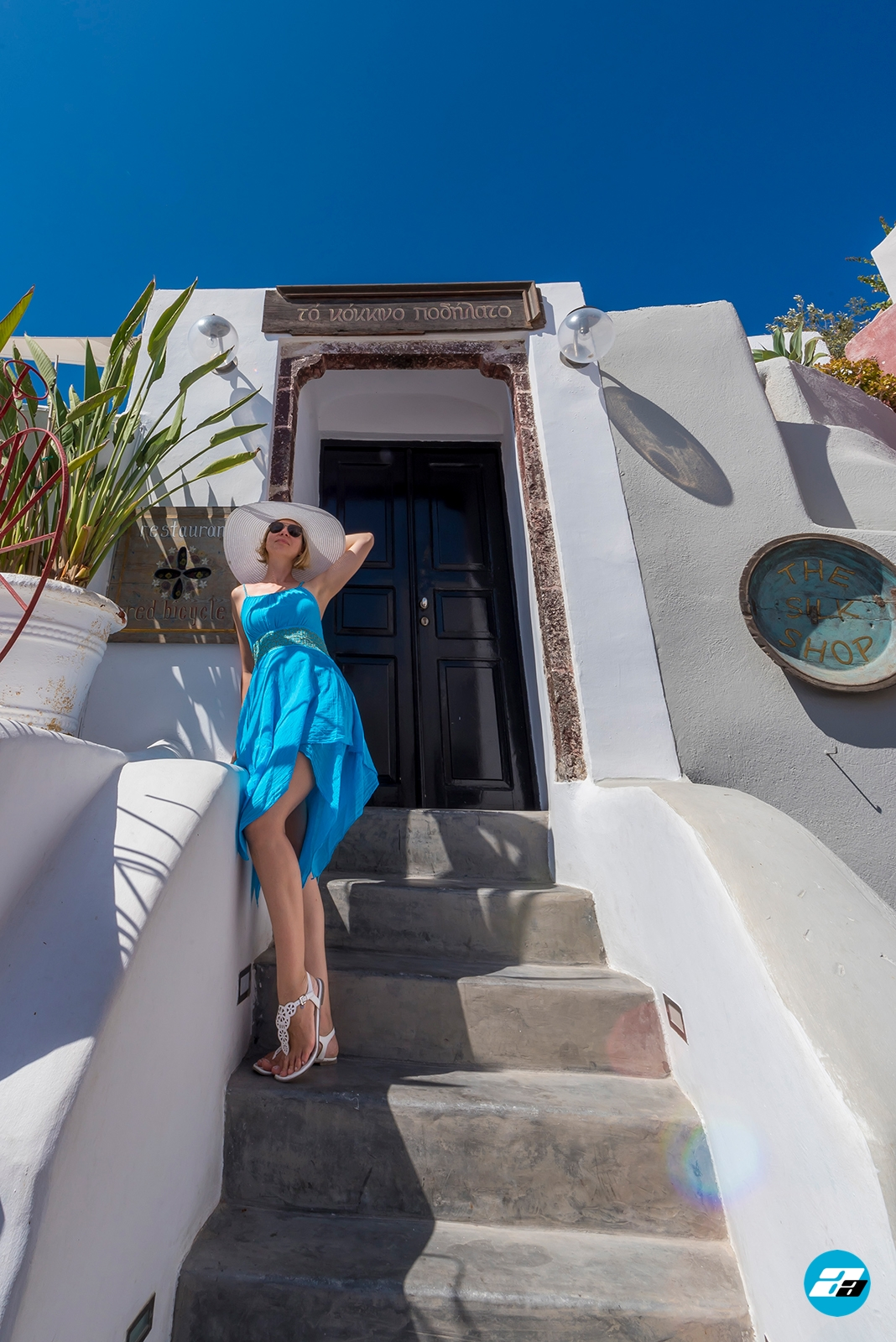 Oia, Santorini, Greece. Santorini Travel. Fashion Model. Blue Dress. White Hat.