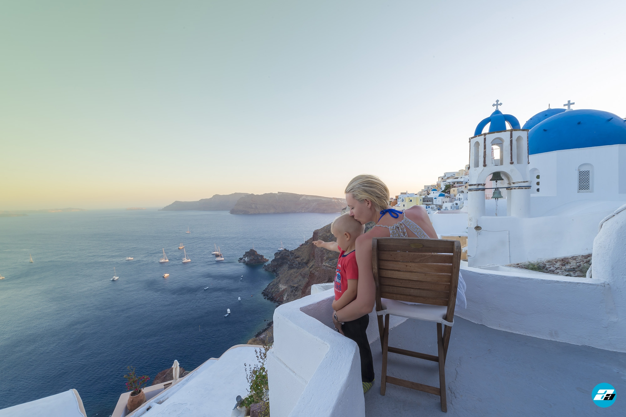 Oia Santorini Greece. Blue domes of Oia. Family. Mother and Son. Family adventure. Travelers.