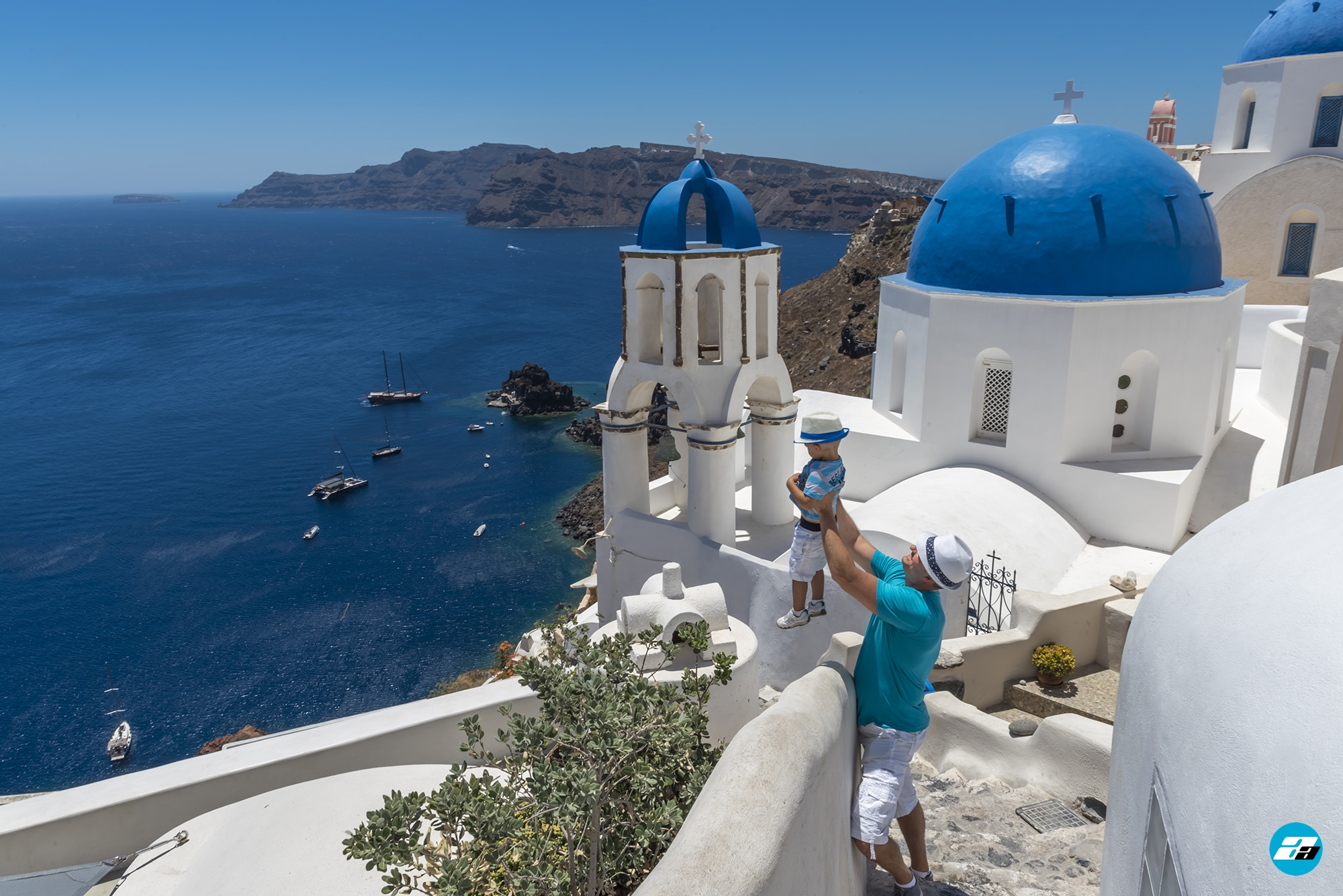 Oia Santorini Greece. Blue Domes of Oia. Family. Father and Son.