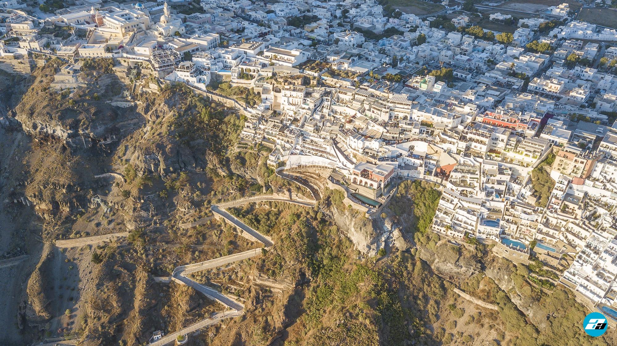 Fira, Santorini Greece. Santorini Capital. Fire from above. Aerial Photo